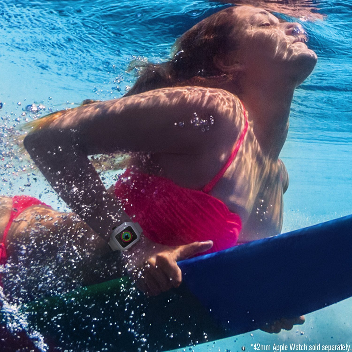 Woman swimming wearing an Apple Watch covered in a Catalyst case.