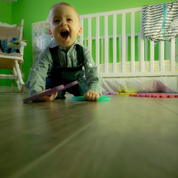 full length of boy sitting on floor 315265