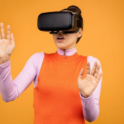 woman in long sleeve shirt wearing vr goggles 3761308