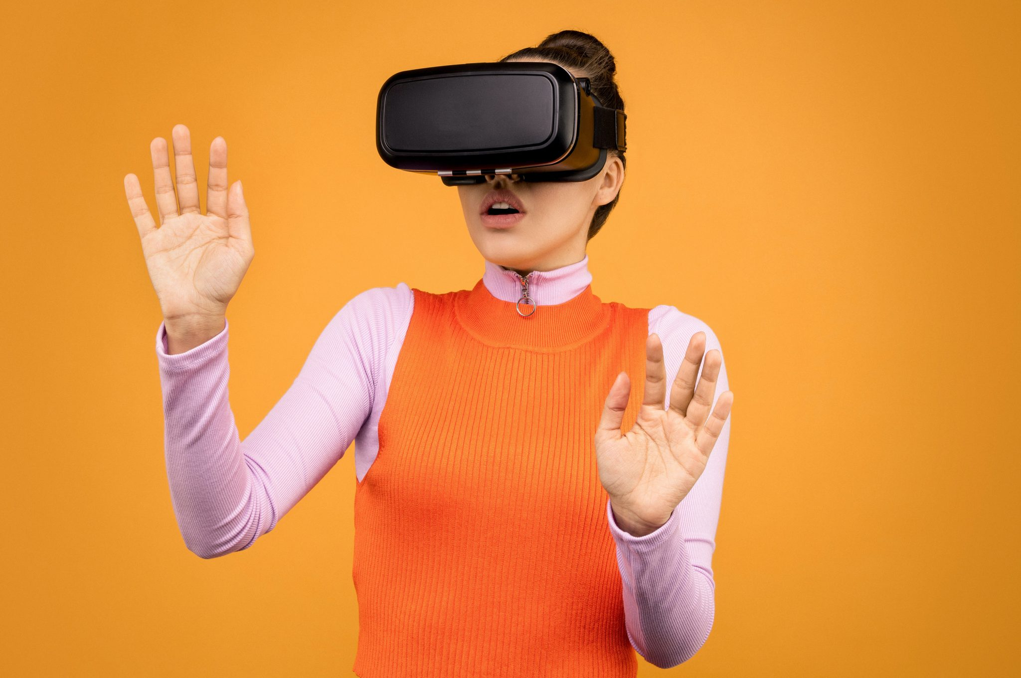 woman in long sleeve shirt wearing vr goggles 3761308 scaled