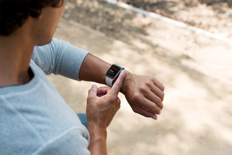 Person using Apple Watch ECG app.